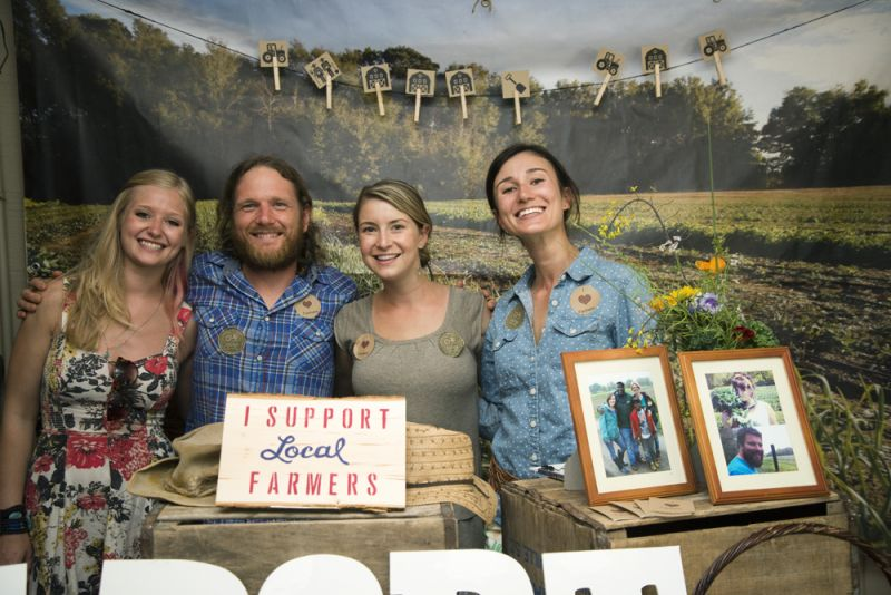 "LLF members Leah Highfield (Farm Apprentice), Chris Miller (Teaching Plot Manager), Tasha Pavlovich (Apprentice), and Avril Fabian man the table where patrons could ""adopt"" plants and support local farmers."