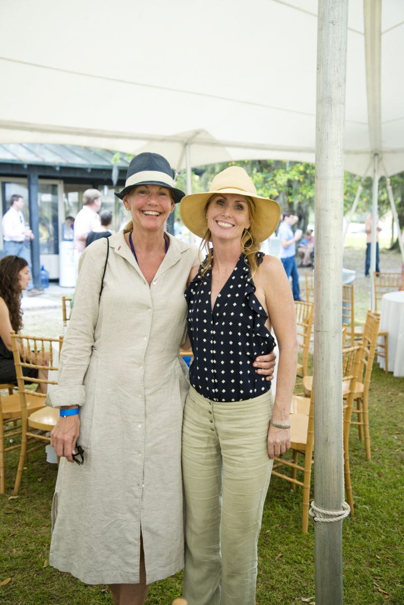 Stacie McCormick and Leslie Turner enjoy the sunny afternoon under the tent.