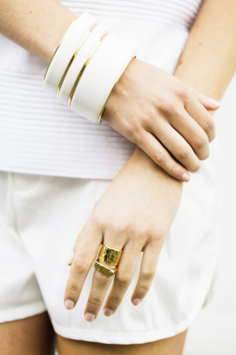 "White bangles with gold rim by Ben-Amun for Isaac Manevitz, $80-$130, at Berlin's for Women; 14K gold-plated rings, both by Christina Jervey, $115 & $125, at christinajervey.com; ""Ringer"" tee, $290, & ""Ladson"" twill shorts, $190, both by Troubadour at troubadourclothing.com"