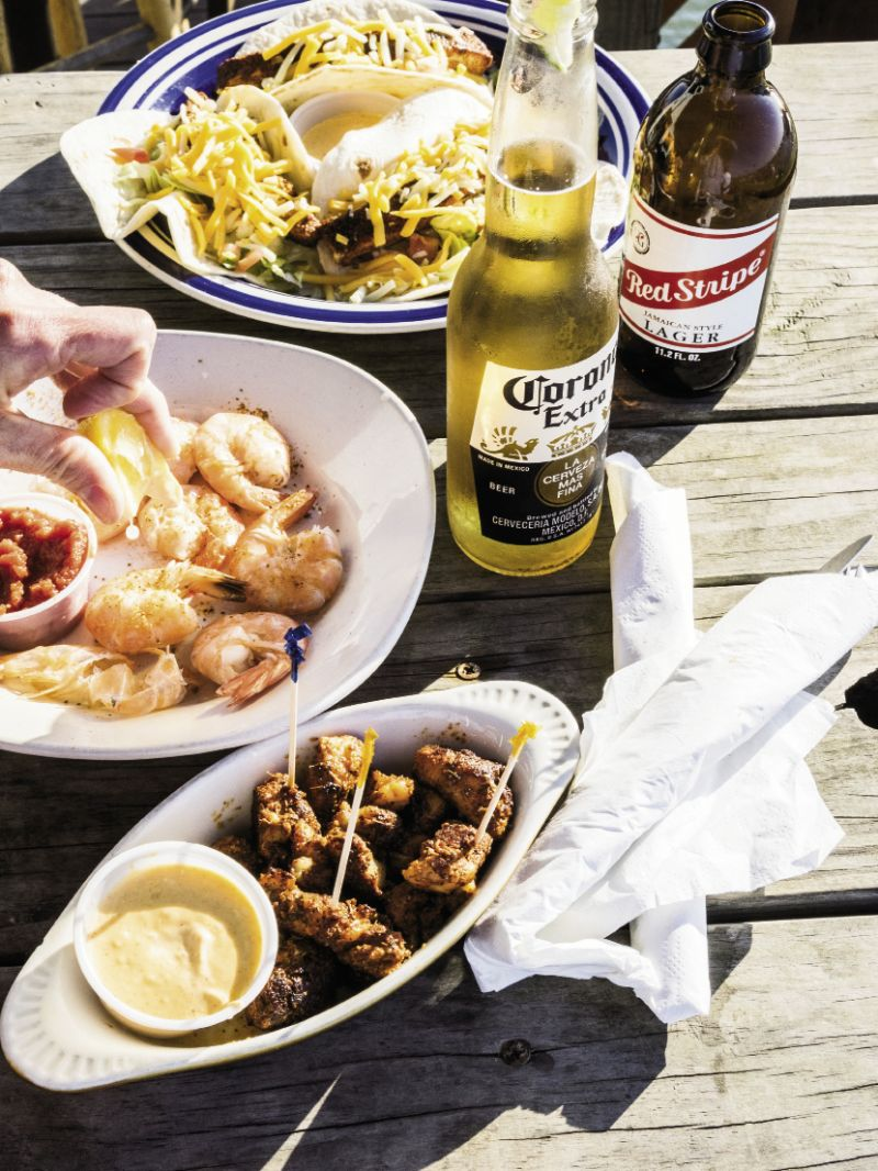Snag an outdoor table at Sunset Cay for fish tacos, steamed shrimp, and blackened grouper bites.