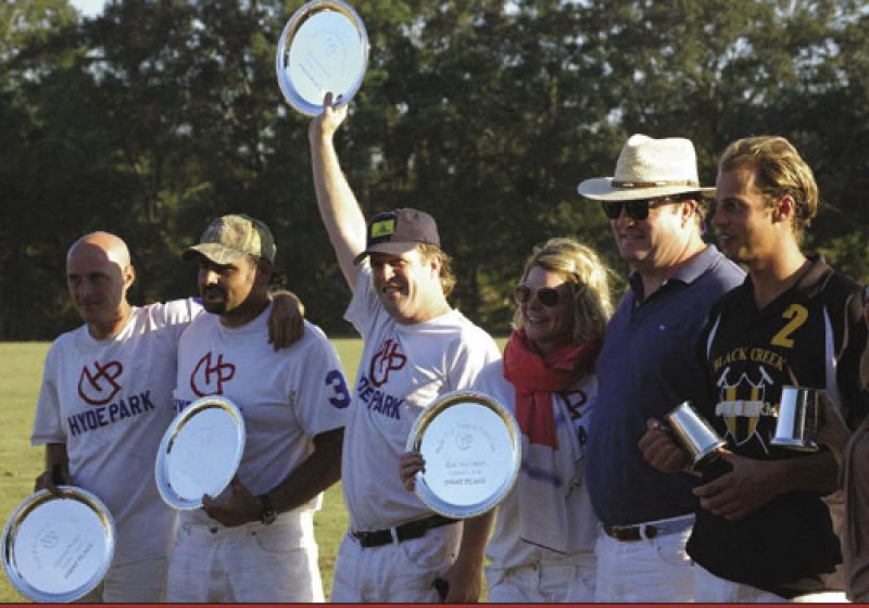 Presenting the silver, like stomping the divots, is a cherished ceremony. Plates go to the members of the winning team, cups to the runners-up. After the presentation, players talk to the fans, sit their children on the ponies, and explain the game to newcomers. Amy Vann Flowers (right, center) presides over this ceremony at Hyde Park Farm & Polo Club, a full-service polo school and facility that she built on family property near Ravenel.