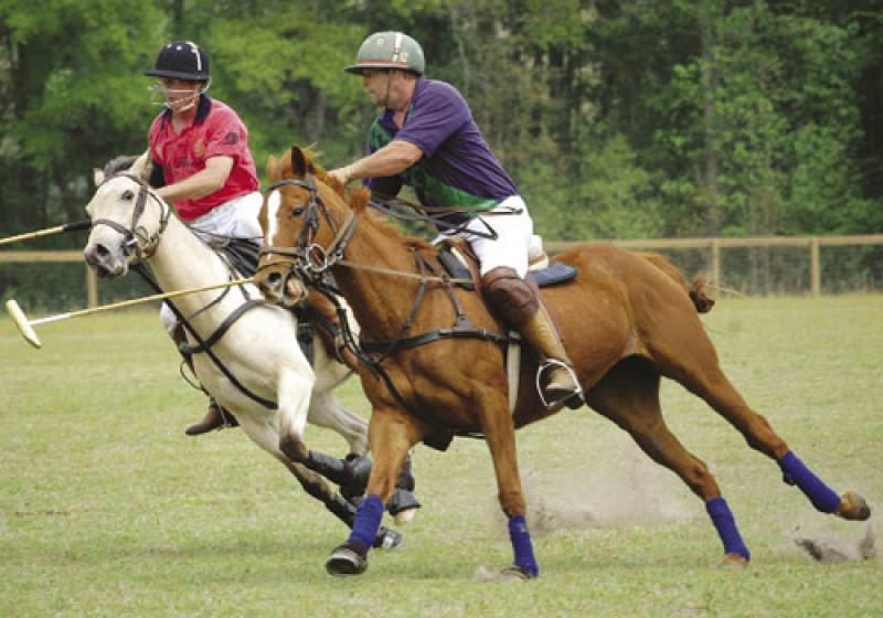 A game of skill, speed, and power, it's often played at full gallop and in a perilous lean, as demonstrated by Batt Humphreys in red and Barry Limehouse in blue.
