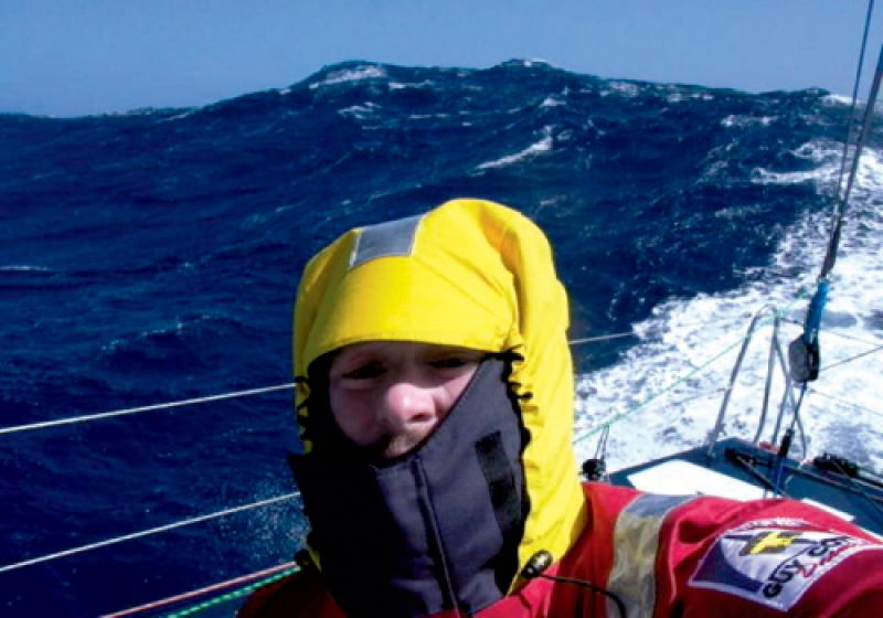Brad braves rough seas in full offshore weather gear, including harnesses to strap himself to the boat.
