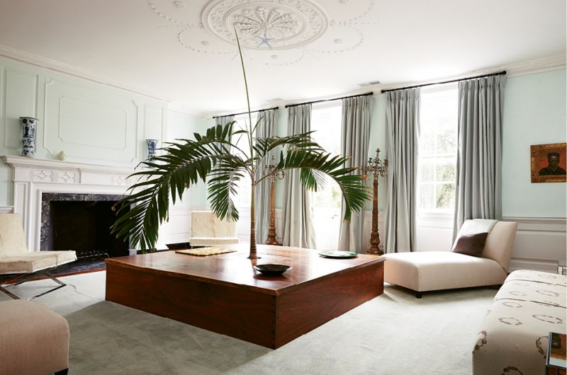ELEMENT OF SURPRISE: De Givenchy designed this seven-by-seven-foot square table, crafted by Savannah-based furniture maker Greg Guenther from 100-year-old walnut, around an unexpected centerpiece: a live palm tree.