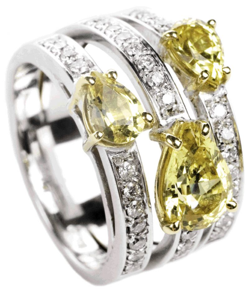 FRUITFUL BOUNTY: 18K white  gold trio ring with pear-shaped yellow sapphires (2.38 total ct.) and accent diamonds (.45 total ct.) Skatell's, $9,750