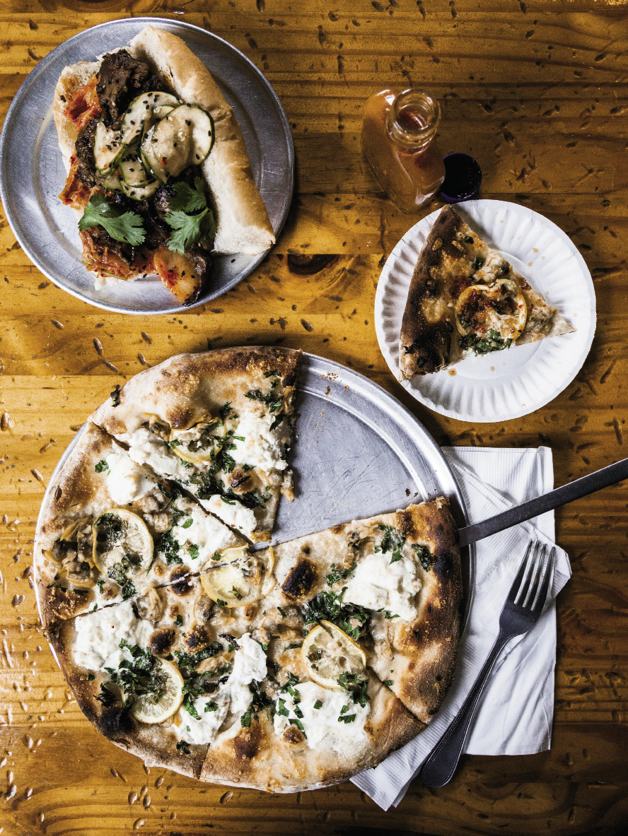 The 'Wich Doctor's incredible white clam pizza is made in the Neapolitan style and topped with garlic oil, ricotta, Parmesan, Italian parsley, and lemon.