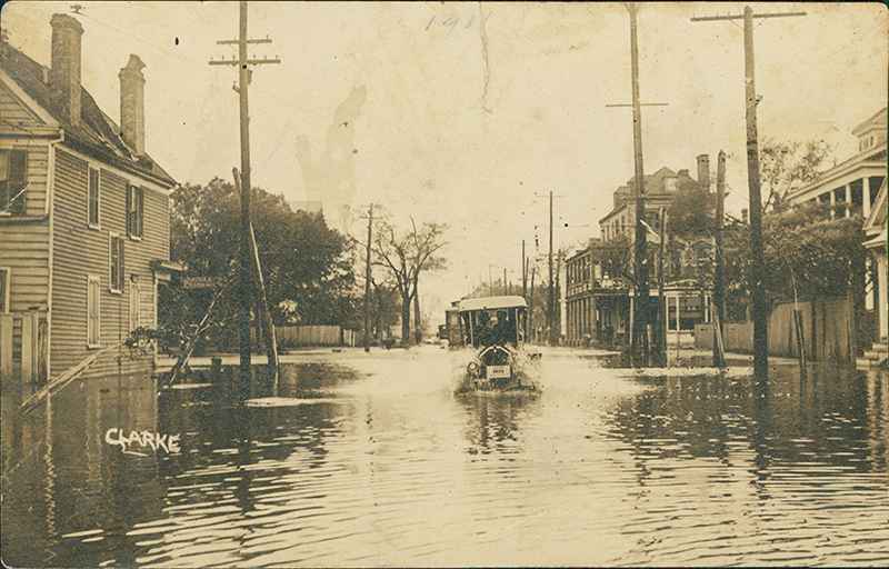 "1,000 Years of Floods: As these vintage images show, flooding in Charleston is nothing new. (Above) a pencil marking indicating ""1911"" suggests this car, sloshing down the street most likely near the corner of Rutledge and Calhoun, was a victim of the September 1911 flood.  Photograph courtesy of Ed Reynolds"