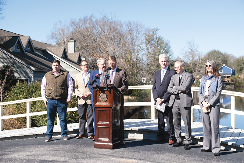 In January 2019, a press conference to introduce Dutch Dialogues was held in West Ashley, at an area of repeated flooding in the Church Creek basin. Mayor John Tecklenburg (third from left) asserted his commitment to solving flooding problems. To his left: Winslow Hastie, CEO of Historic Charleston Foundation, as well as Dutch Dialogues consultants Dale Morris, David Waggonner, and Janice Barnes.  Photograph by Sarah Alsati