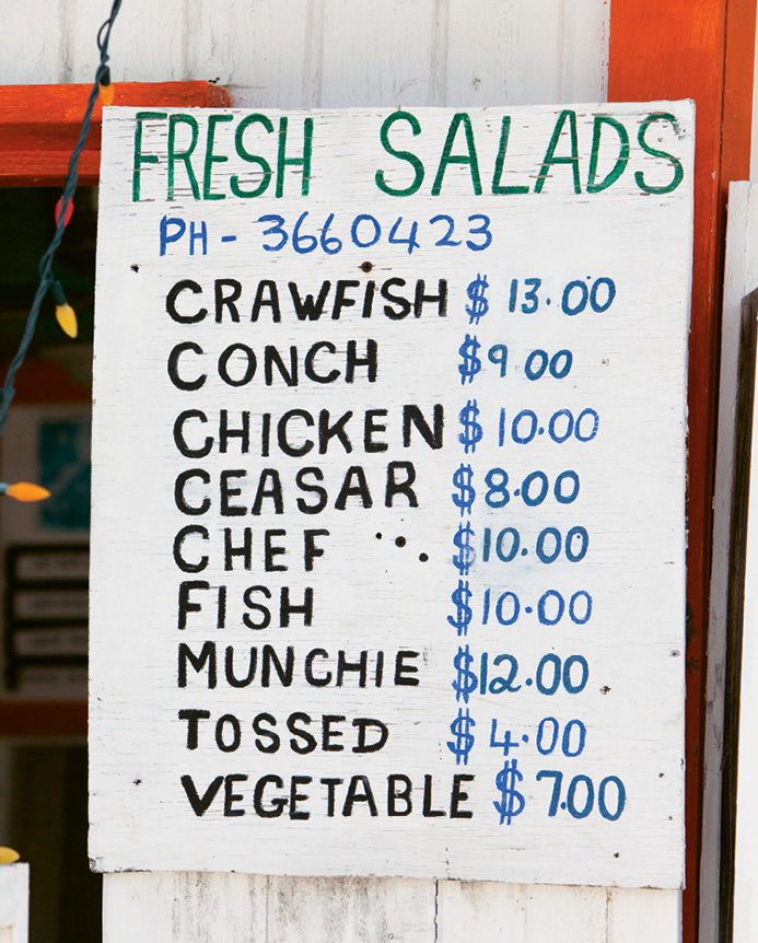 The menu board at a roadside lunch shack in Hope Town