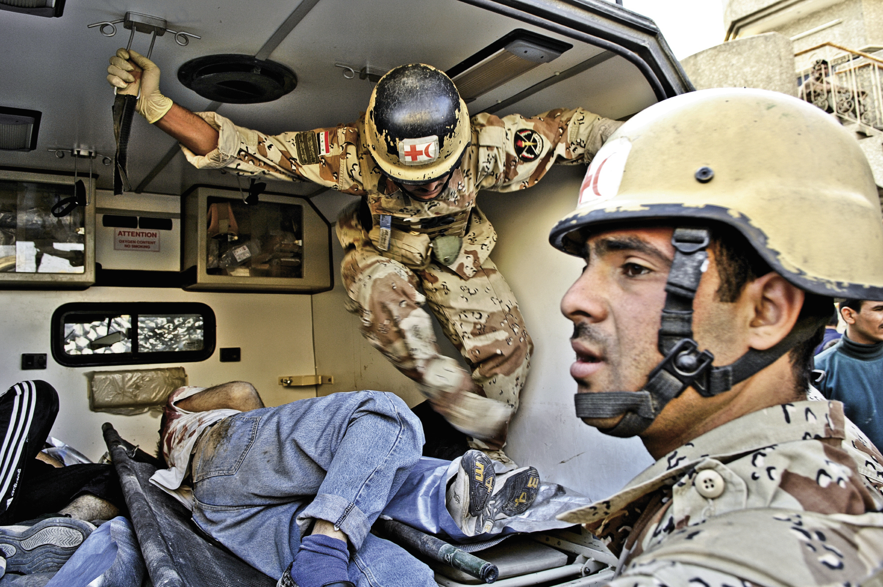 March 29, 2007: Iraqi Army soldiers load the bodies of deceased enemy forces into a waiting ambulance in Baqubah, Iraq.