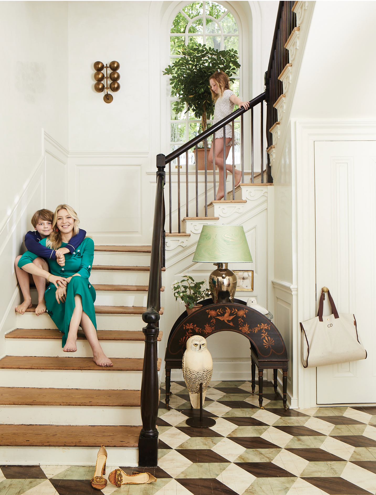 Donnelley in the foyer of her East Bay Street home, with son Raff and daughter Hayes, where family heirlooms, like a carved owl that was ever-present in the New York City brownstone where she grew up, are prized amid the designer's artful aesthetic.