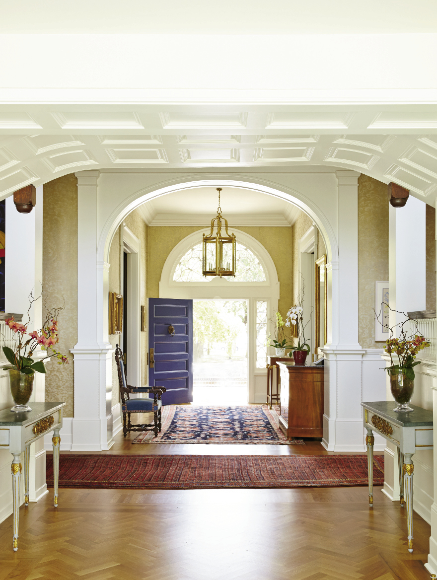 Throughout the home, all windows and wainscoting are original, as is most of the flooring. Florals by Lotus Flower
