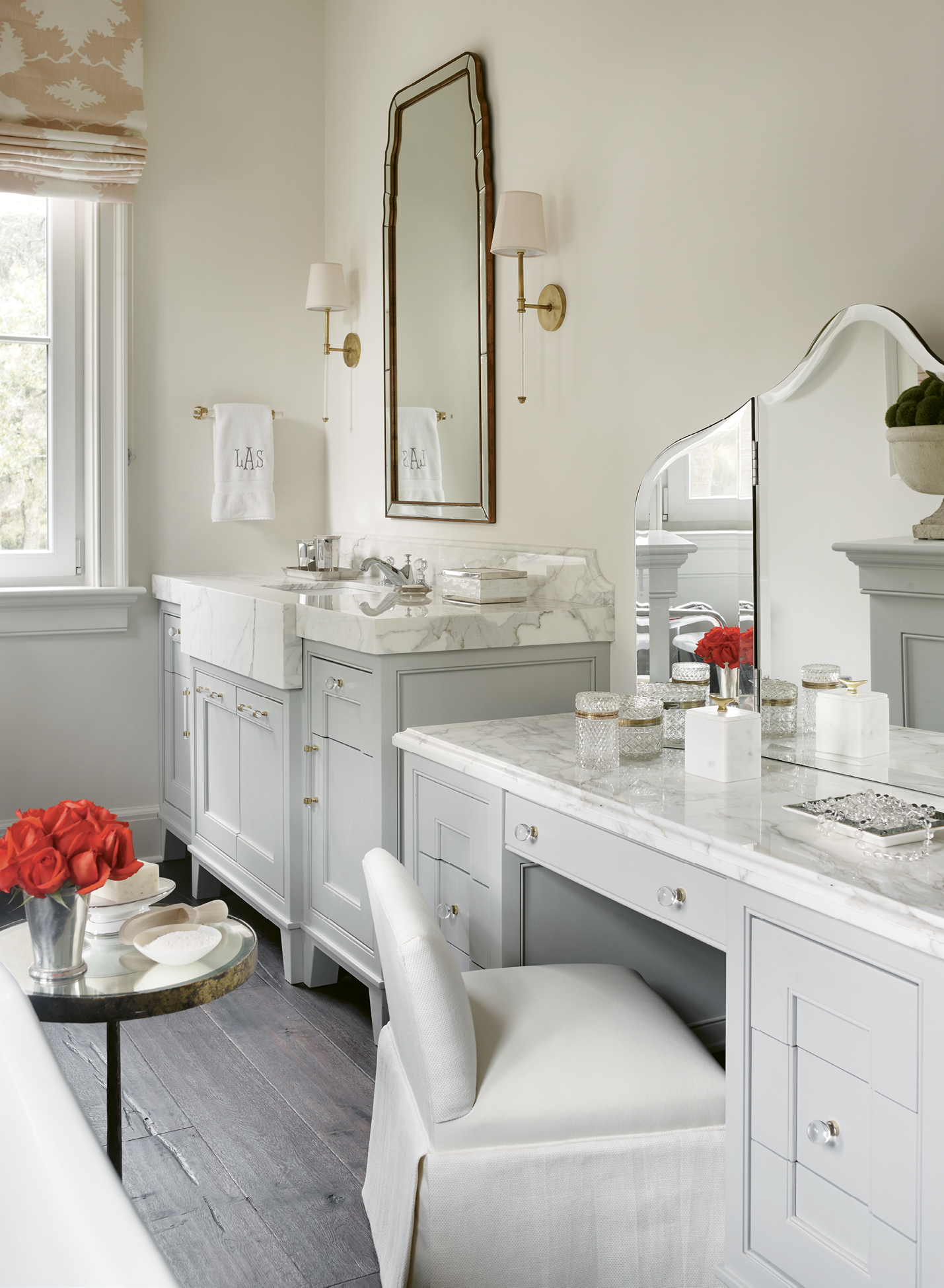 The suite is outfitted with his-and-her baths; Leah's includes a dressing table complete with a custom vanity stool.