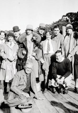 Belle (pictured in fur coat and hat) with family and friends on the Hobcaw dock in 1935;