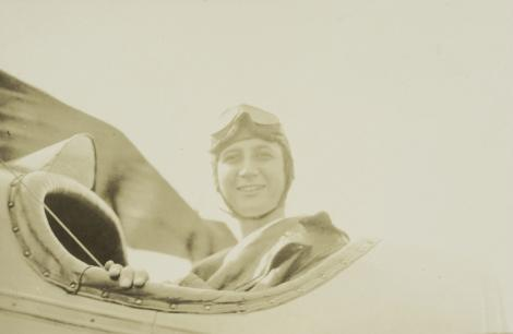 In the cockpit on her first flight with friend and pilot Evangeline Johnson in 1916