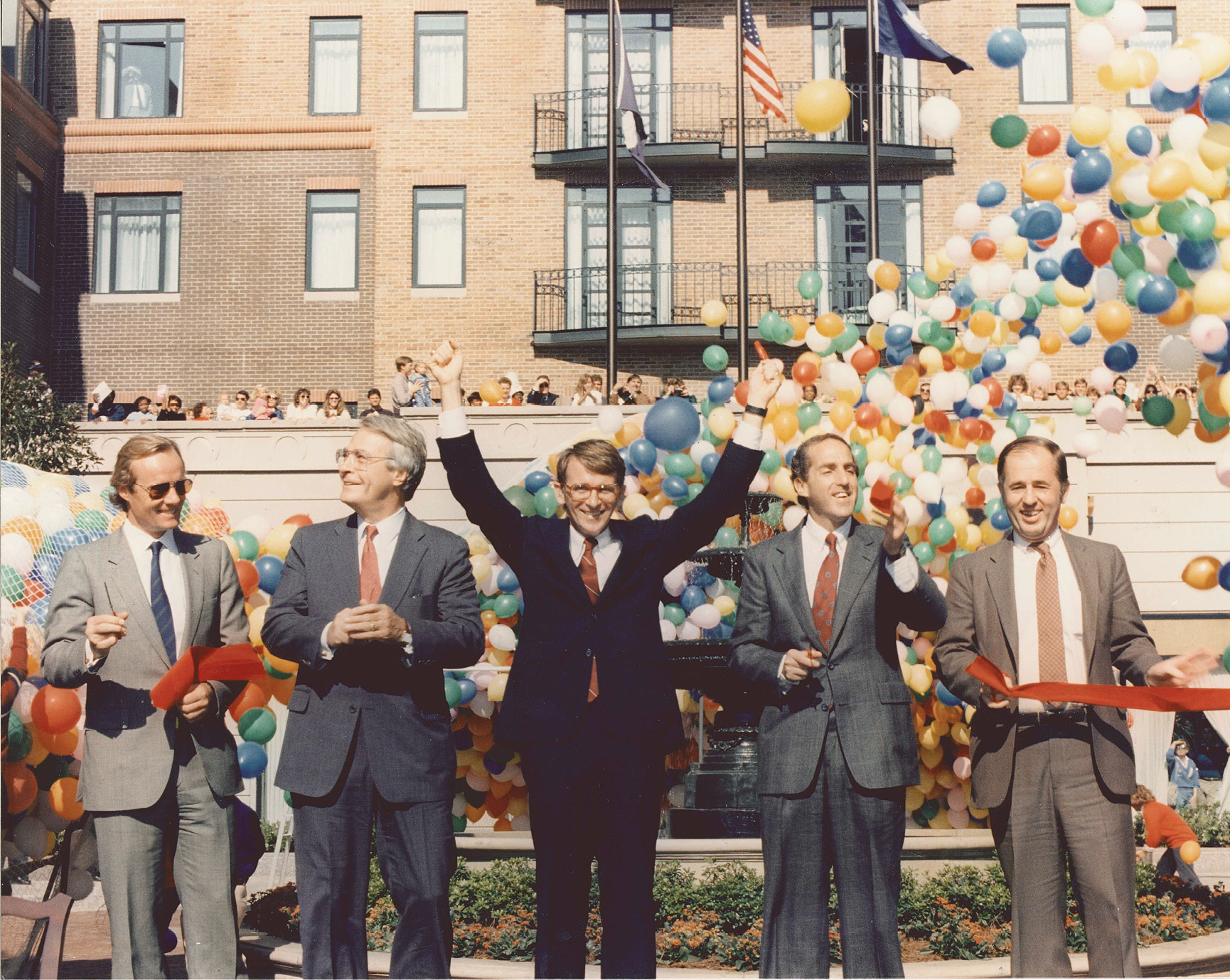 Then-Mayor Joseph Riley Jr. (left center) celebrates the opening of Charleston Place on September 2, 1986.