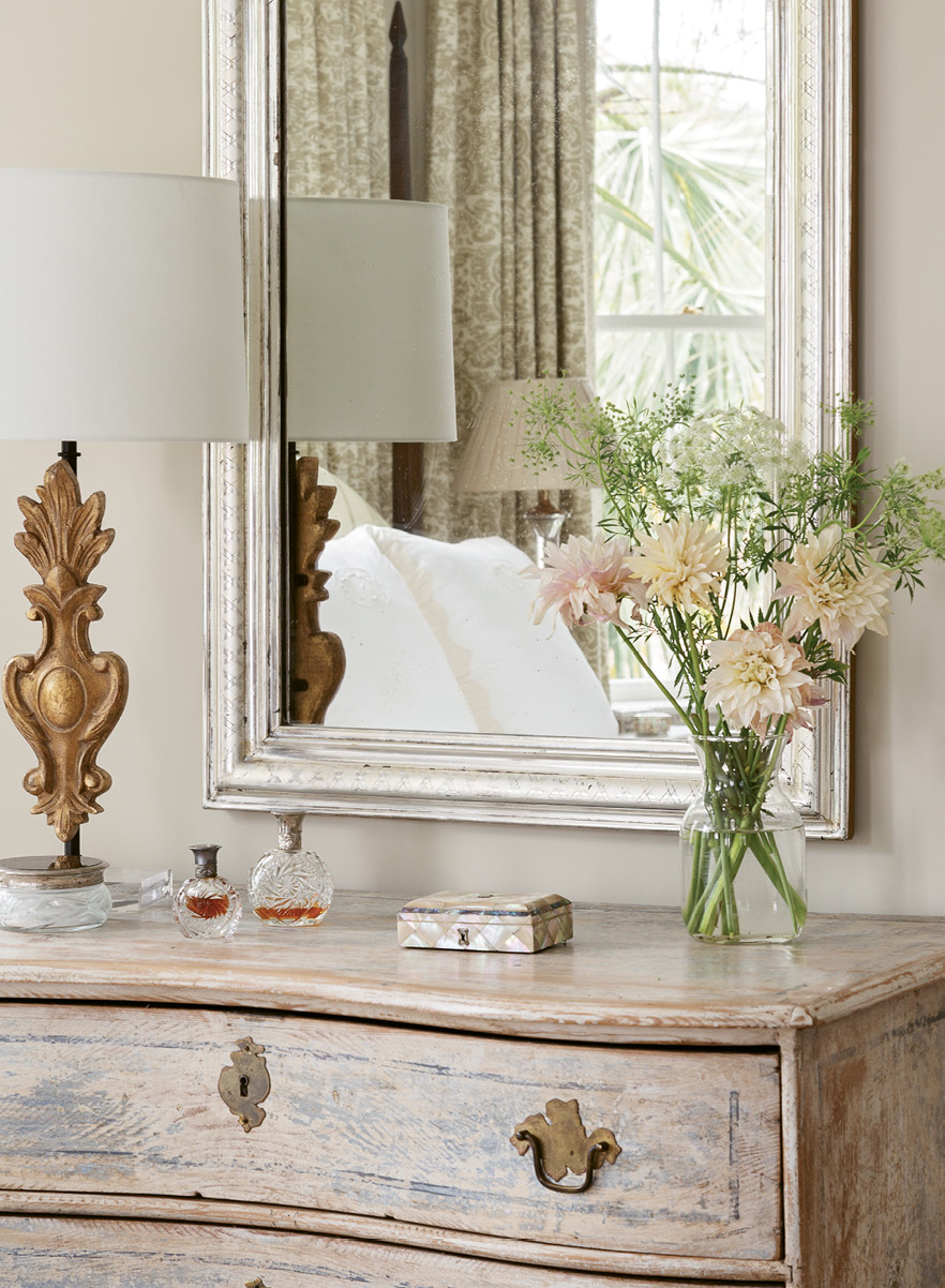 A Louis Philippe mirror tops a serpentine dresser.