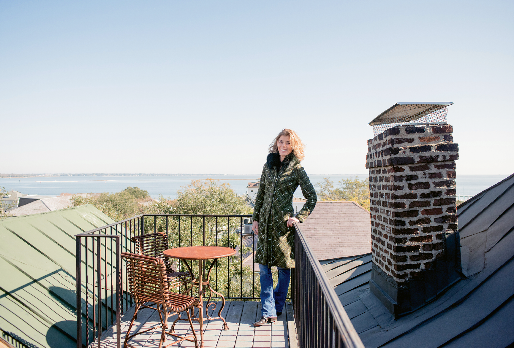 THE LONG VIEW: Pollak takes in some fresh air from her four-story home's petite rooftop deck, which offers stunning views of Charleston Harbor and Fort Sumter.