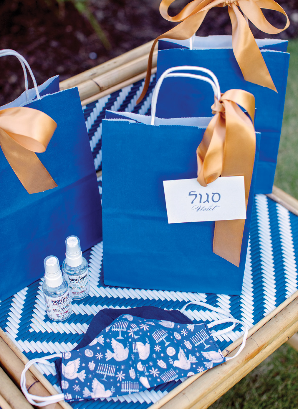 Hanukkah's blue and white palette is accented by silver, as well as gold, in the welcome bags, which offer local Bittermilk hand sanitizer and festive masks