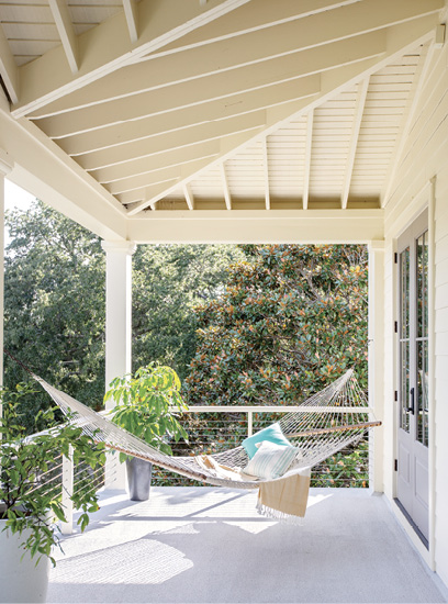 Hang Time: With four porches, there's always an outdoor perch for sitting and soaking up the sunshine, such as this double hammock, a housewarming gift, off the guest rooms.