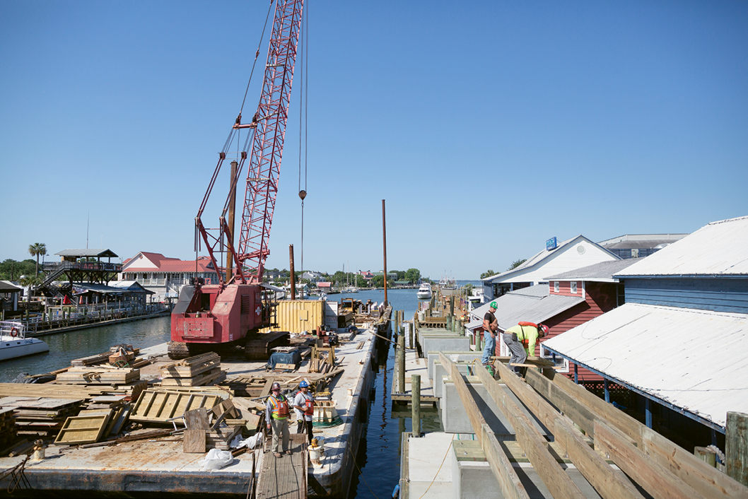 The town-funded construction of public walkways along the northwestern shore.