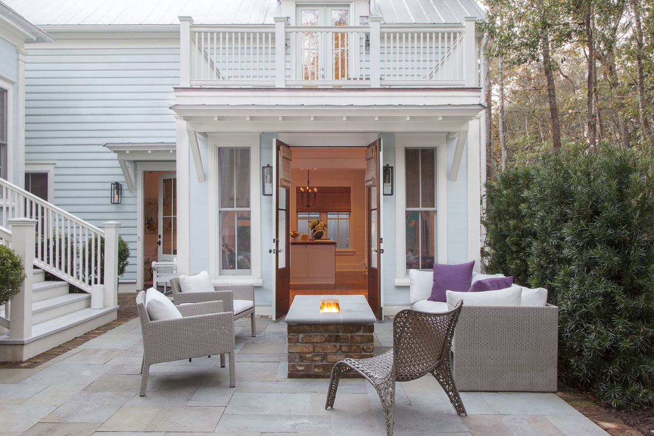 Barn doors open onto the patio, making the outdoor space feel like a natural extension of the interiors.