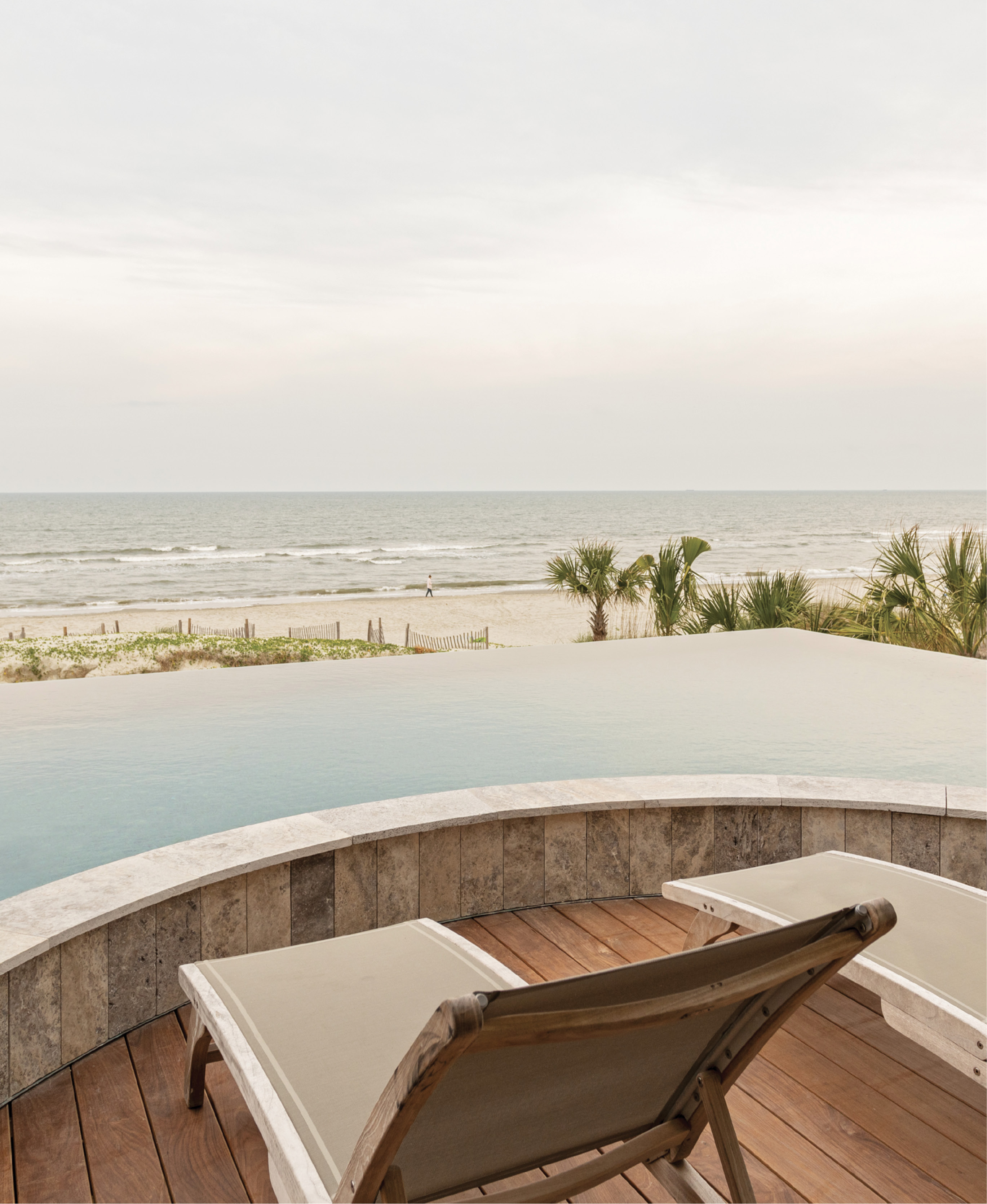 """Dream Digs - Looking out from the infinity pool to the atlantic beyond, the Leonards can't help but pinch themselves. The couple, who met here nearly 30 years ago, have realized their dream—to return to the Lowcountry and live on the beach. Check out the family's grand but decidedly """"unfussy"""" Isle of Palms oceanfront home."""