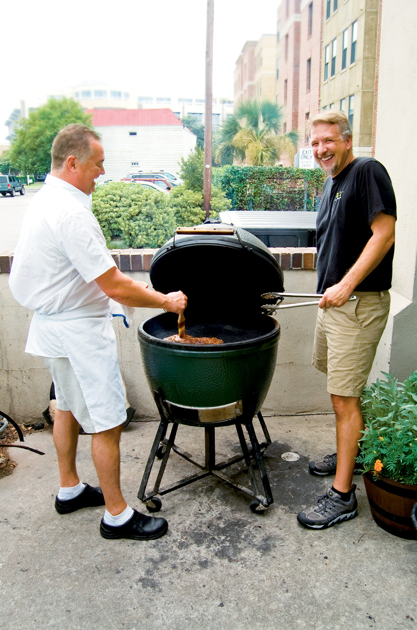BUTCHER: Ted's Butcherblock; here, Ted Dombrowski (right) cooks out with Peninsula Grill chef Graham Dailey on the Big Green Egg out back.