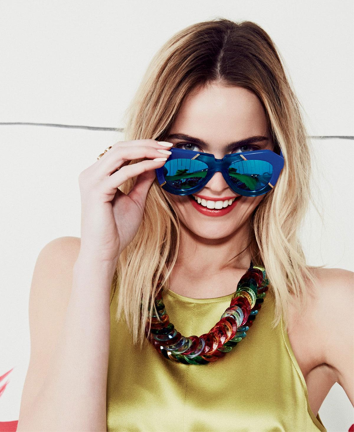 "Karen Walker ""One Splash"" sunglasses in blue and ""crystal aqua,"" $300 at Hampden Clothing; and Clotilde Silva Lucite disk necklace, $78 at Hidden Countship."