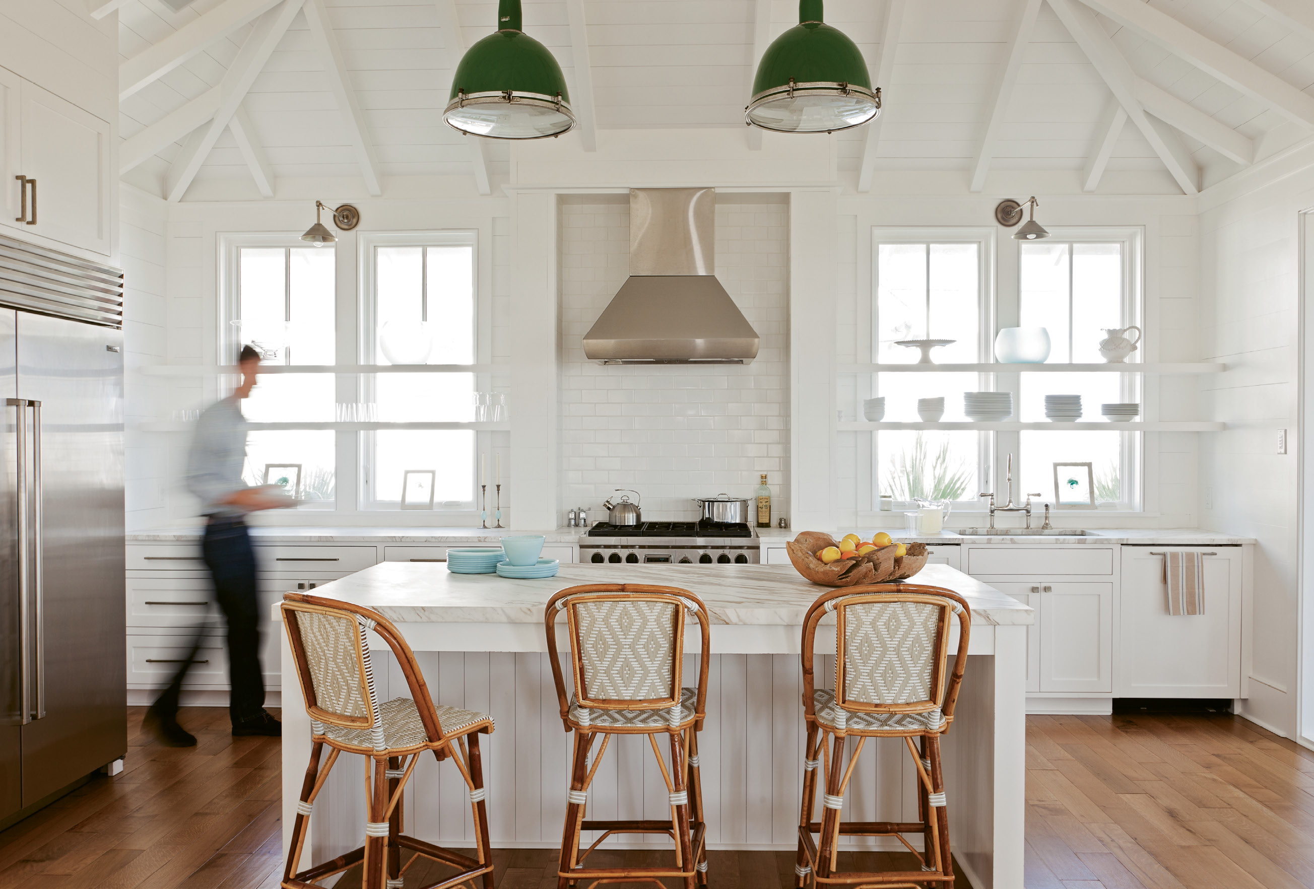 Bright Ideas: Keenan refashioned two old gymnasium lights, hung by a whipped rope cord, as kitchen pendants, adding a pop of color to the mostly white space.