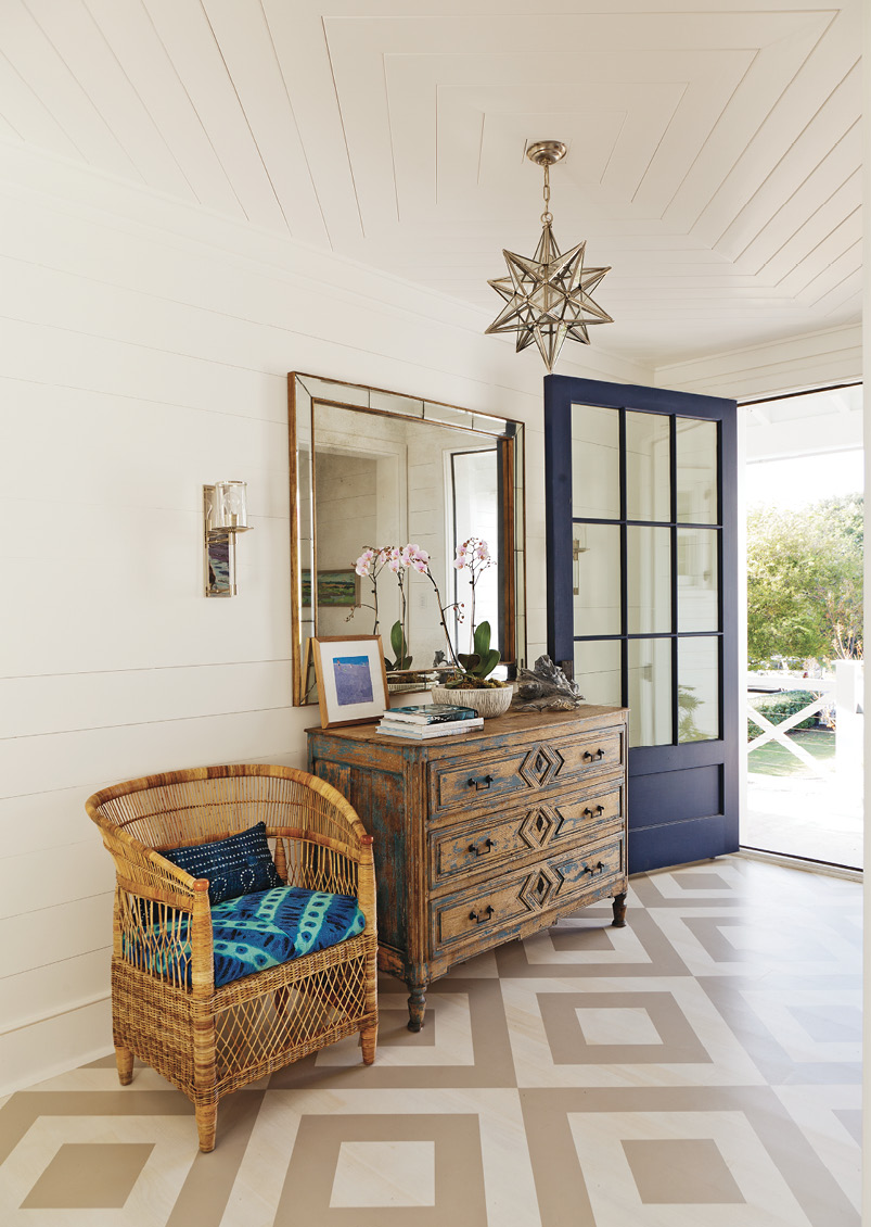 "Pattern Play: The foyer's painted floor ""gives an unexpected punch,"" says designer Jenny Keenan. It sets the tone for the beautiful yet casual and comfortable interiors the homeowners wanted."