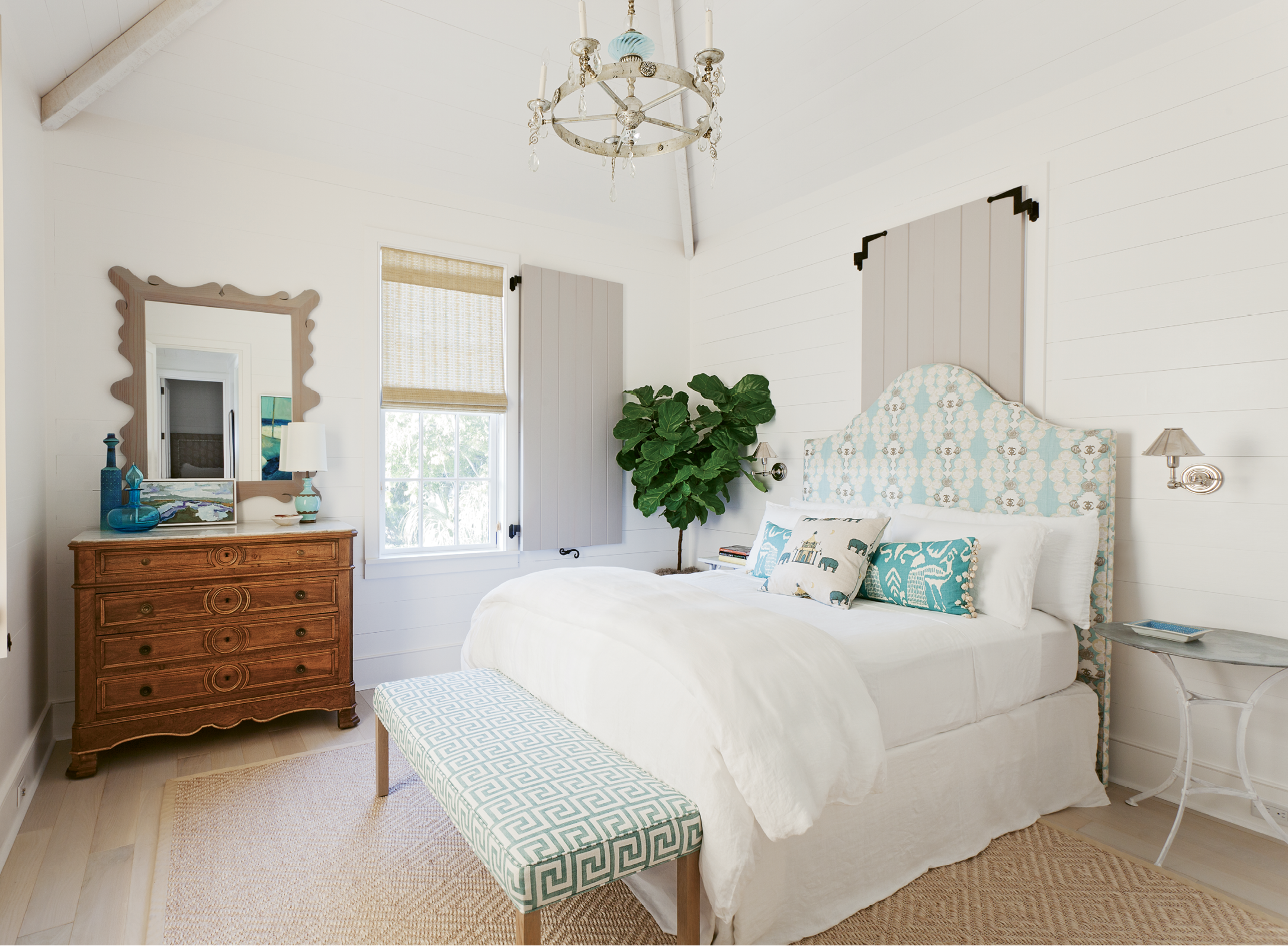 A guest bedroom, outfitted with dreamy creams and blues, proves that comfort and style can come in smaller sizes.