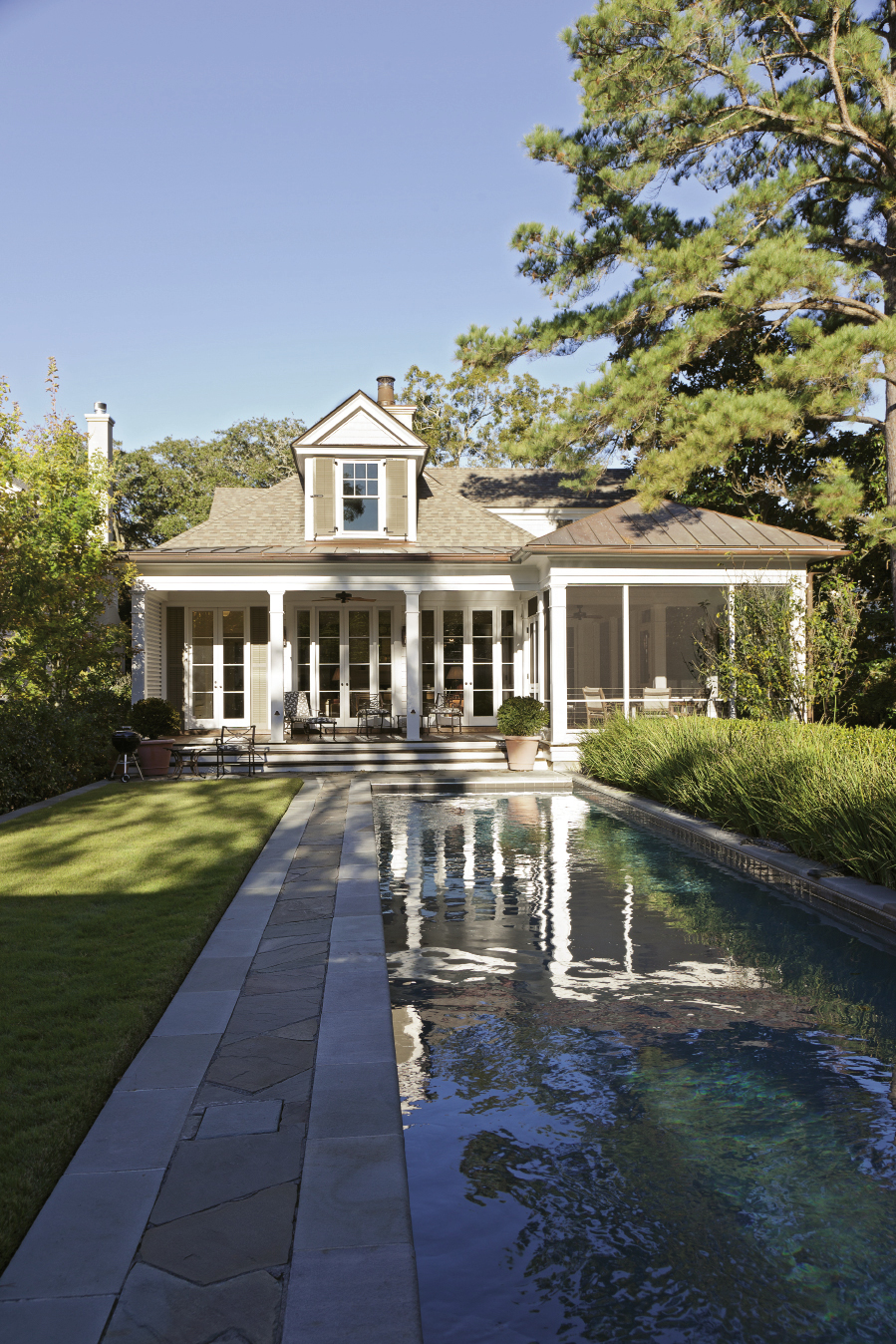 The lawn and pool area are seamless extensions of the house, which was designed by Dufford Young Architects.
