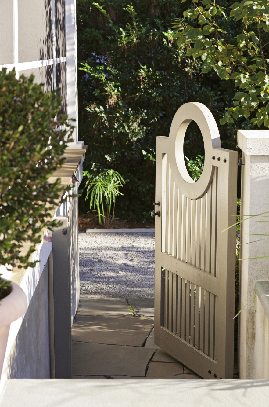 "The back gate leads into a verdant haven in the Old Village, where a subtly dramatic garden awaits, including rows of undulating boxwoods and ""hardy gardenia"" azaleas."