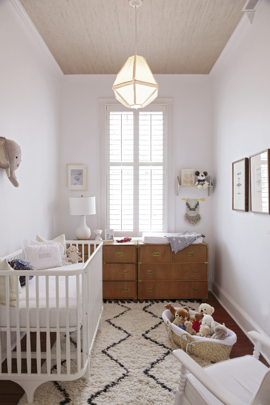 Baby Hugh's nursery (above, right) features a mid-century dresser, handsome grass-cloth ceiling, and vintage airplane prints.