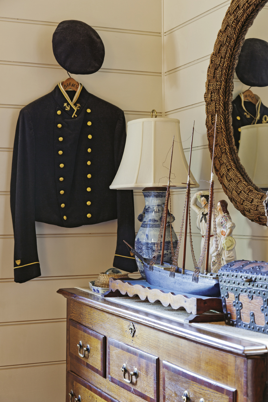 An antique seafarer's uniform graces the second-floor bedroom.