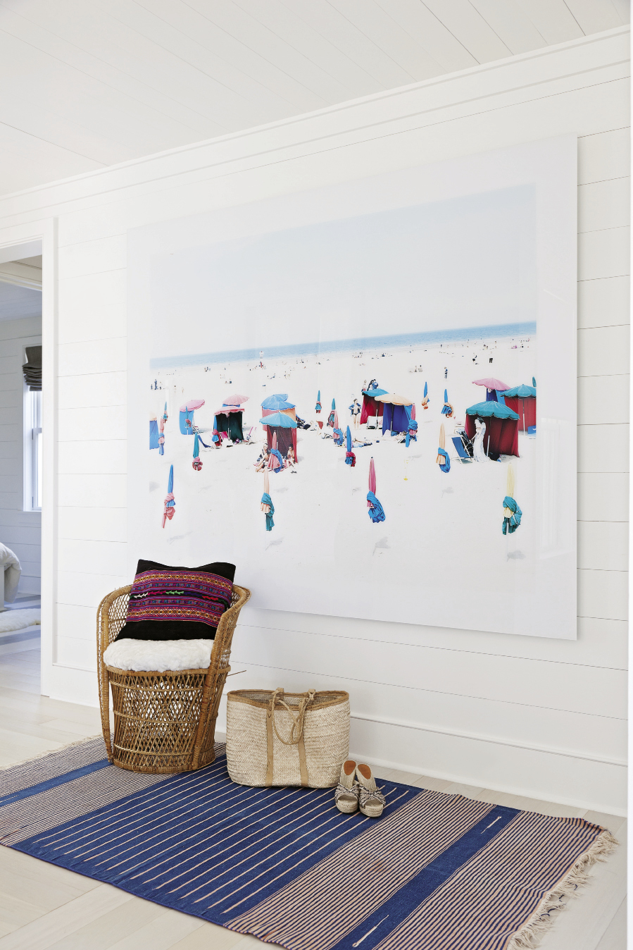 A wall-size panorama by Italian photographer Massimo Vitali makes for captivating beach viewing inside and out.