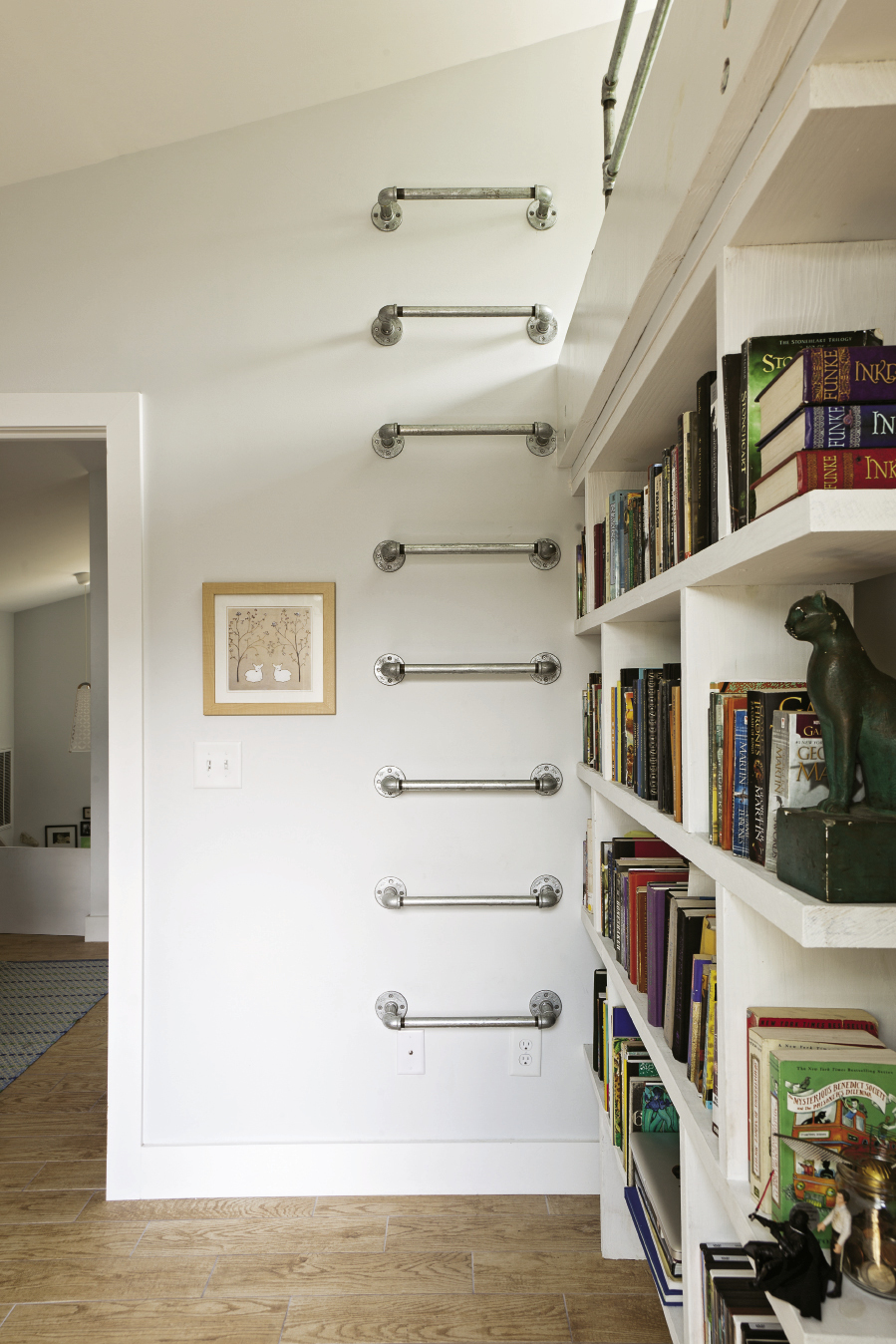 Wall-mounted ladders made of galvanized pipe are also space efficient.