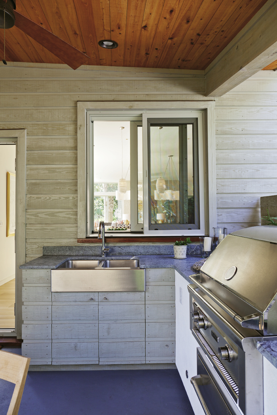Soapstone countertops work in the covered outdoor kitchen because they weather the elements