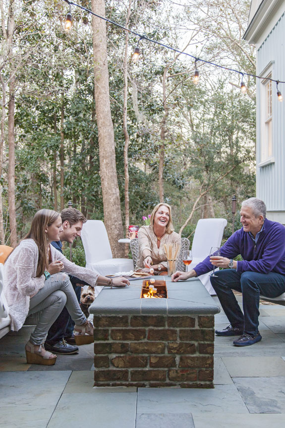 Hot Spot: Boasting a gas fireplace and stunning woodland views, the rear courtyard is the family's favorite place to hang out.