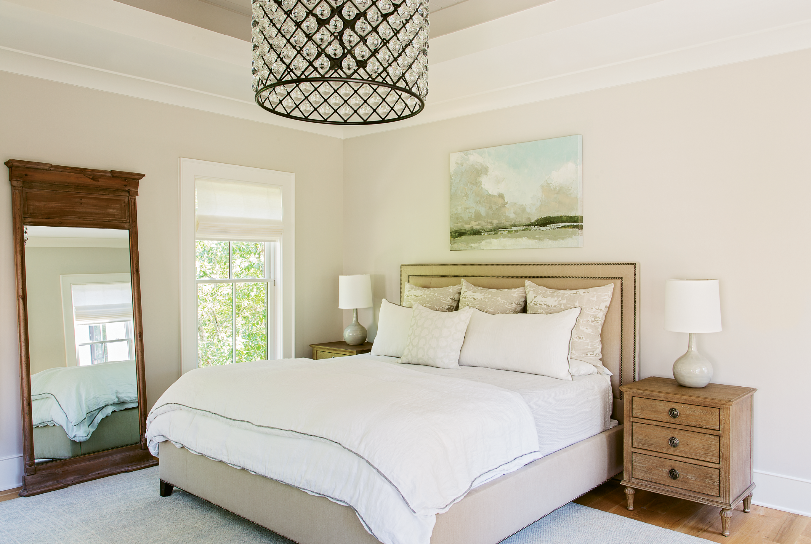 "Dreamy Drama: ""It's my favorite thing in the house,"" says Theresa of the big, dramatic light fixture in the master bedroom, a constellation of mini-globes reflecting light in dazzling gentleness. ""Keeping the décor neutral and simple allows for going big and making statements with the light fixtures,"" notes Lenox."