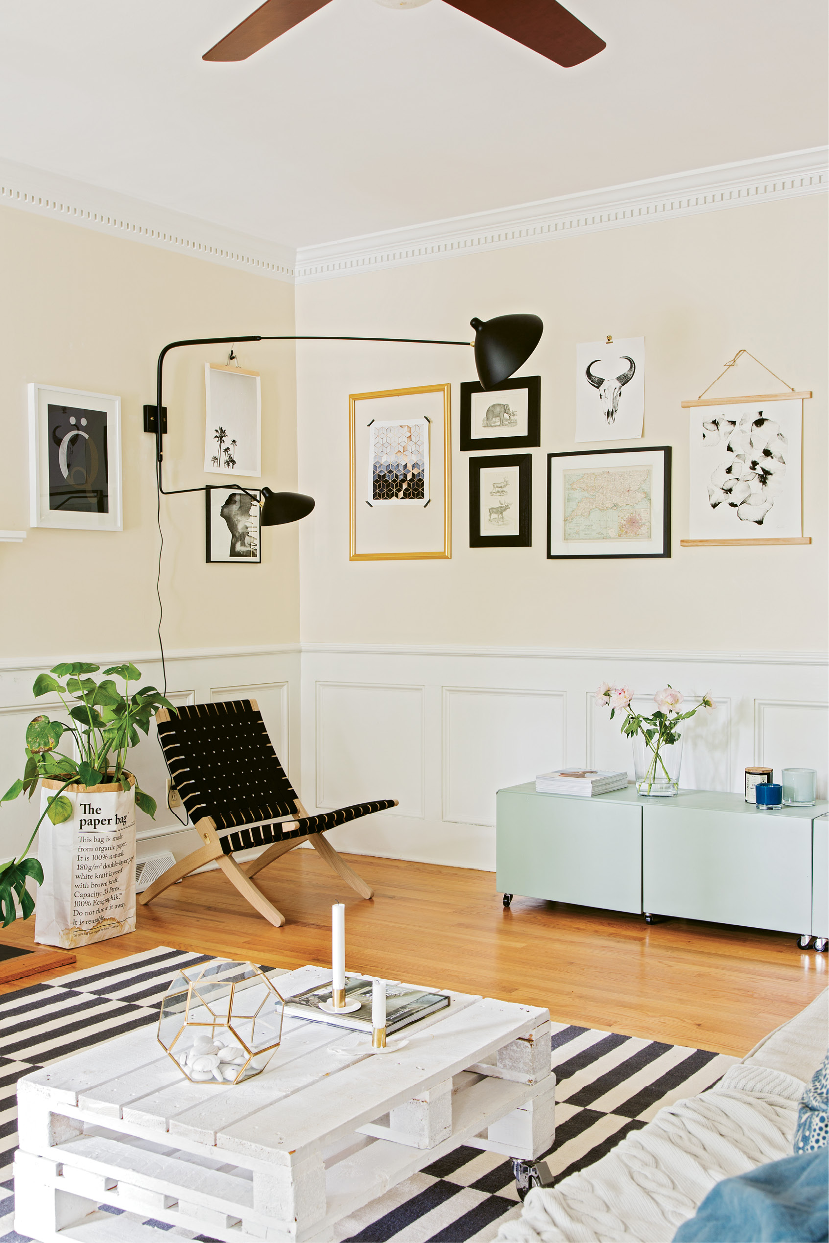 NATIVE STYLE: Therese filled the living room with natural materials, pastel and monochrome color schemes, and lots of plants—all hallmarks of the Swedish design aesthetic. (Opposite top) Gallery walls are found throughout the house; a black-and-white palette connects them all, making the spaces feel cohesive.
