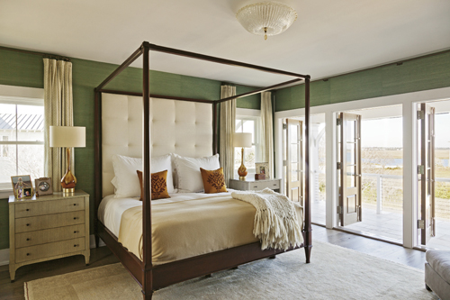 Suite Views: A piazza off the couple's bedroom overlooks the marsh, while the windows in their bath offer harbor views.