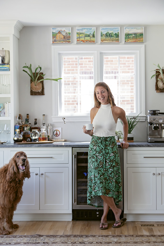 "HOME SWEET HOME: Rachel purchased the property in October 2016. Demolition began by late November, and the following April, she and her Irish setter, Sammy, moved in. ""In the last year, I've hosted Thanksgiving, a big Chanukah gathering, and my neighbors during the snow storm,"" she says."