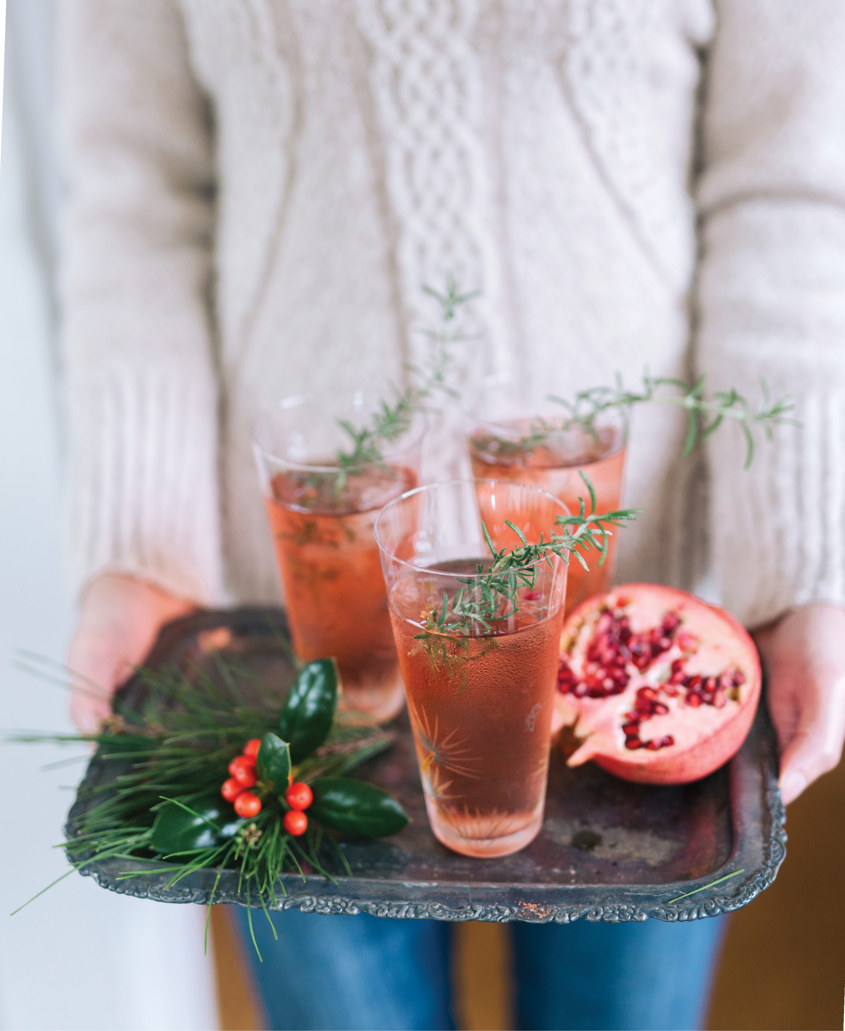 Offer guests a special cocktail, like this pomegranate spritz, as soon as they walk in the door, but do have other options available, as well.