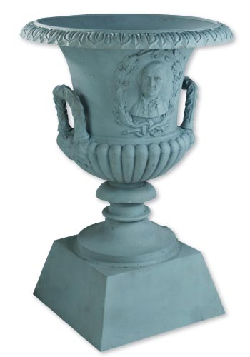 Circa-1860 cast-iron garden urn: Adorned with raised busts of George Washington in laurel wreaths, this 36-inch-high piece is among the garden furnishings Aileen Minor Antiques is bringing from Maryland.