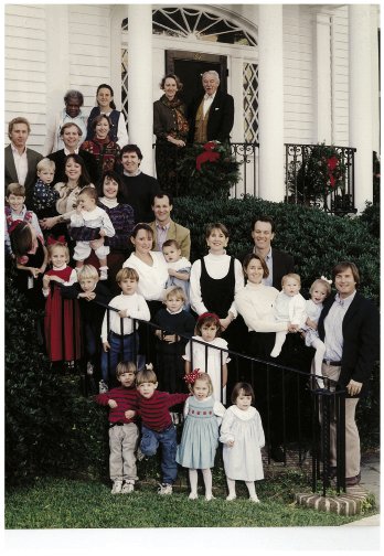 Kulze with her family—parents Dr. Harry and Jane Gregorie and her six siblings and their families—on the steps of her childhood home on King Street in 1995