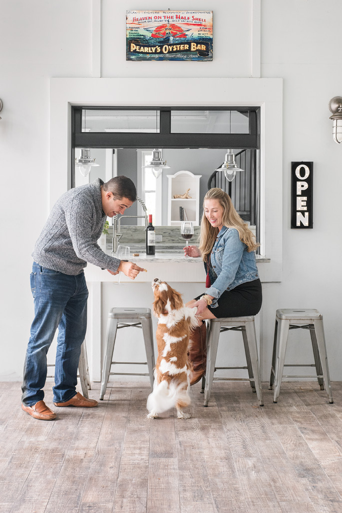 Fun for All: When they're not swimming—the water's a cozy 85 degrees—Valmar, Melissa, and their pup, Mason, can often be found relaxing in the outdoor living space, complete with a bar.