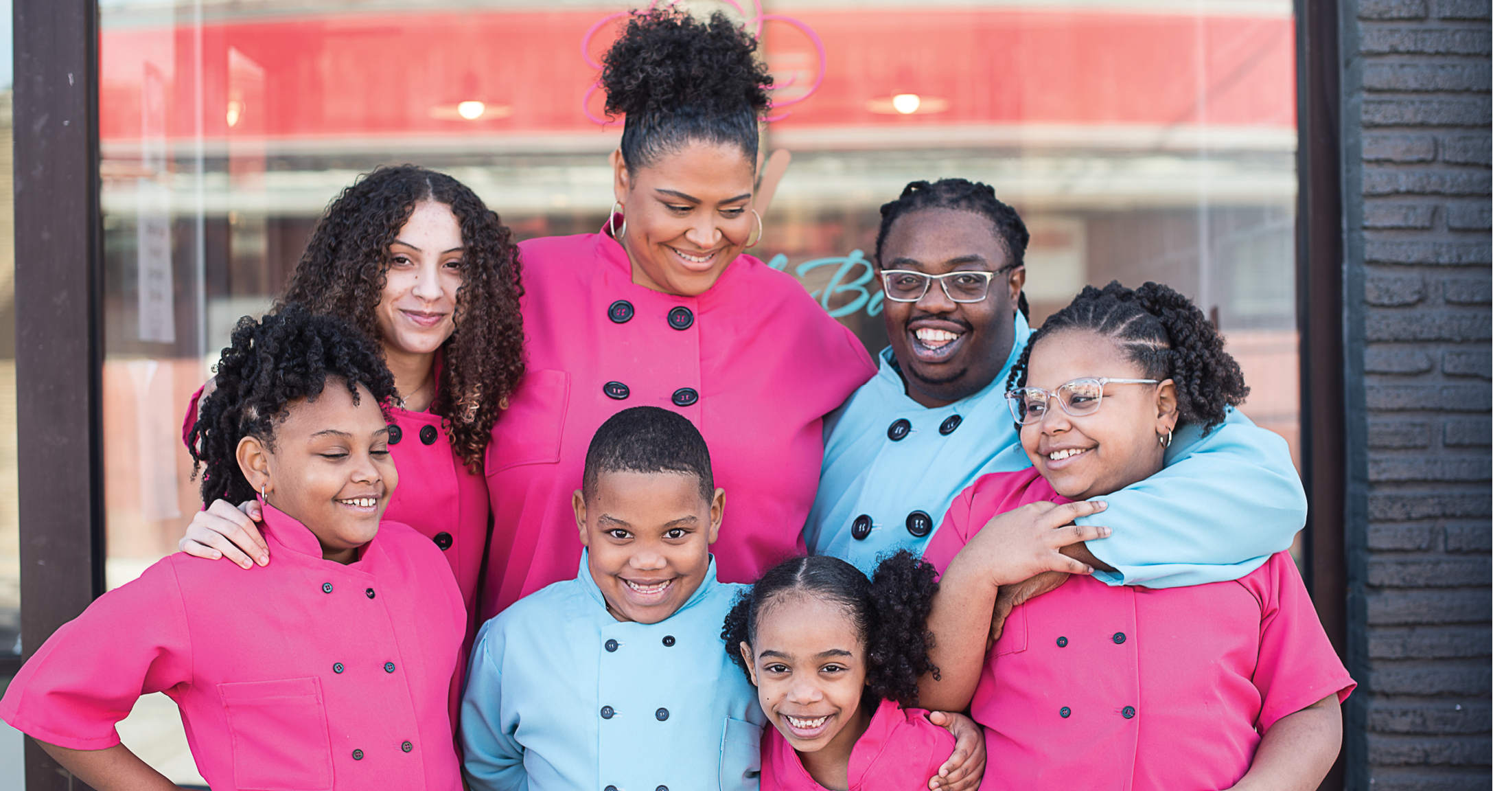The Brown family in front of the bakeshop they opened on Reynolds Avenue in January.