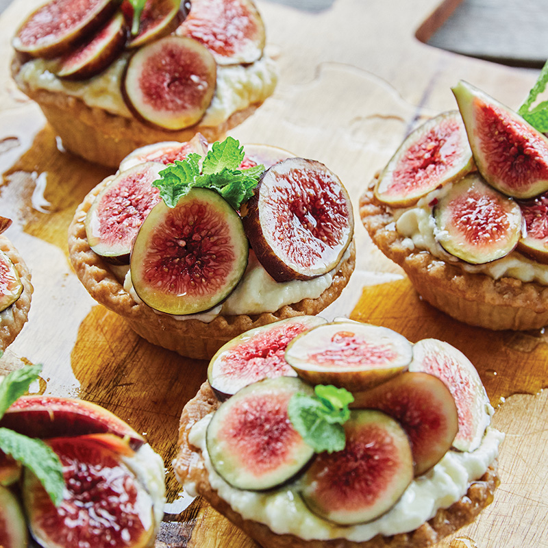 Hot honey and cool mint play against sweetened mascarpone in this rustic tart, which the chef tops with in-season figs, such as Celeste and black mission.